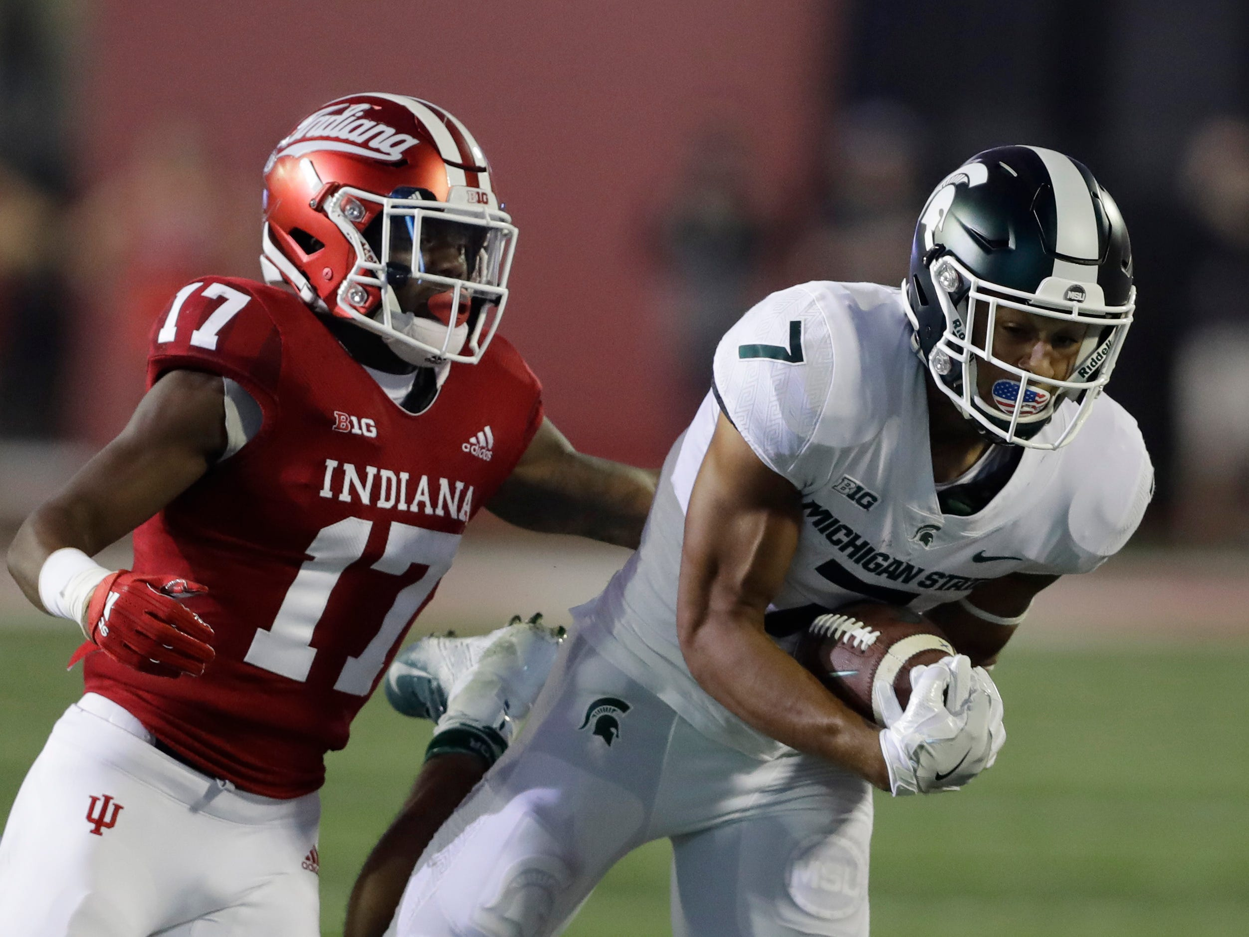 Michigan State wide receiver Cody White (7) makes a catch against Indiana's Raheem Layne during the first half of an NCAA college football game, Saturday, Sept. 22, 2018, in Bloomington, Ind.