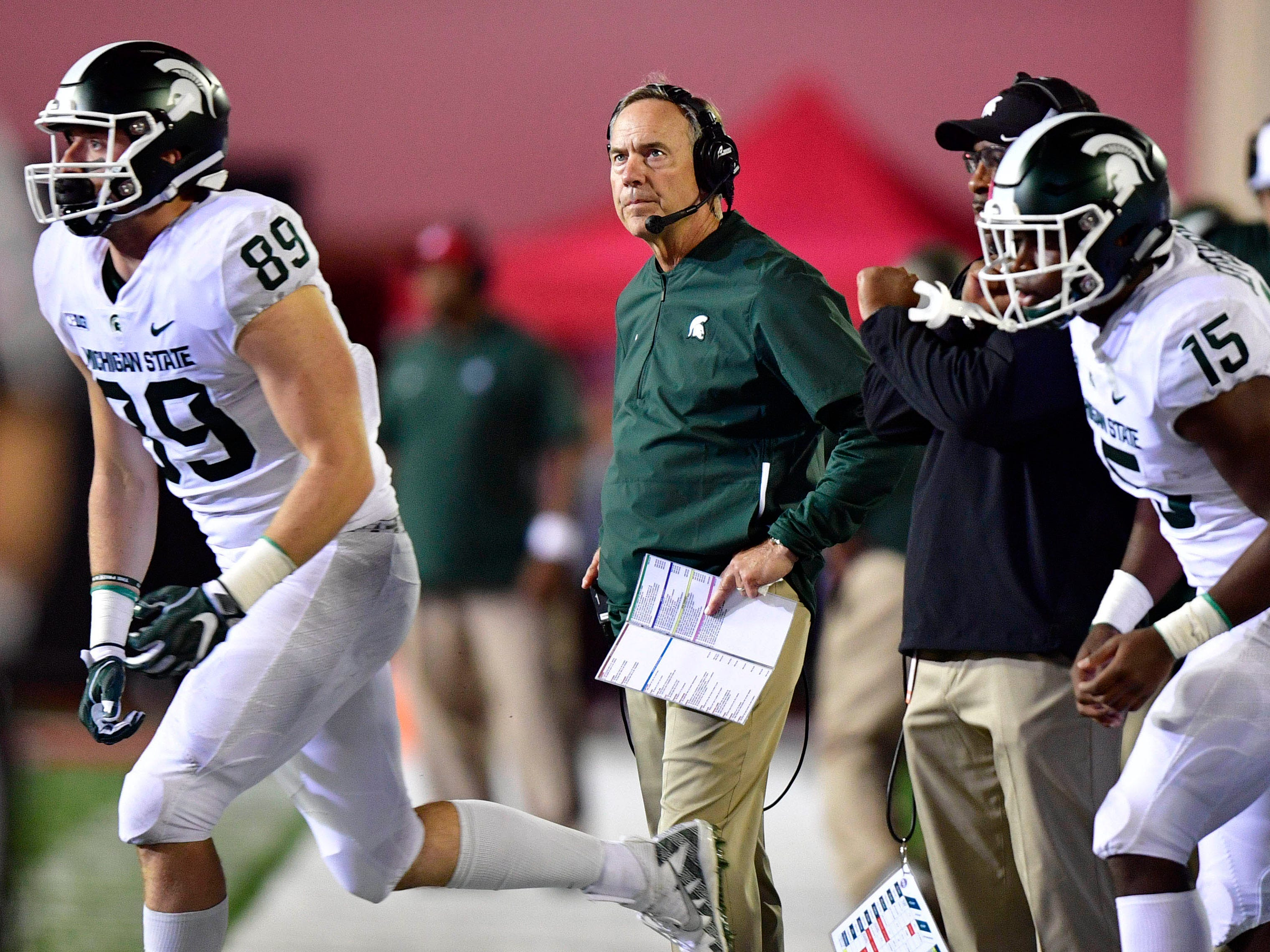 Mark Dantonio watches a replay during the second half against Indiana on Sept. 22, 2018.