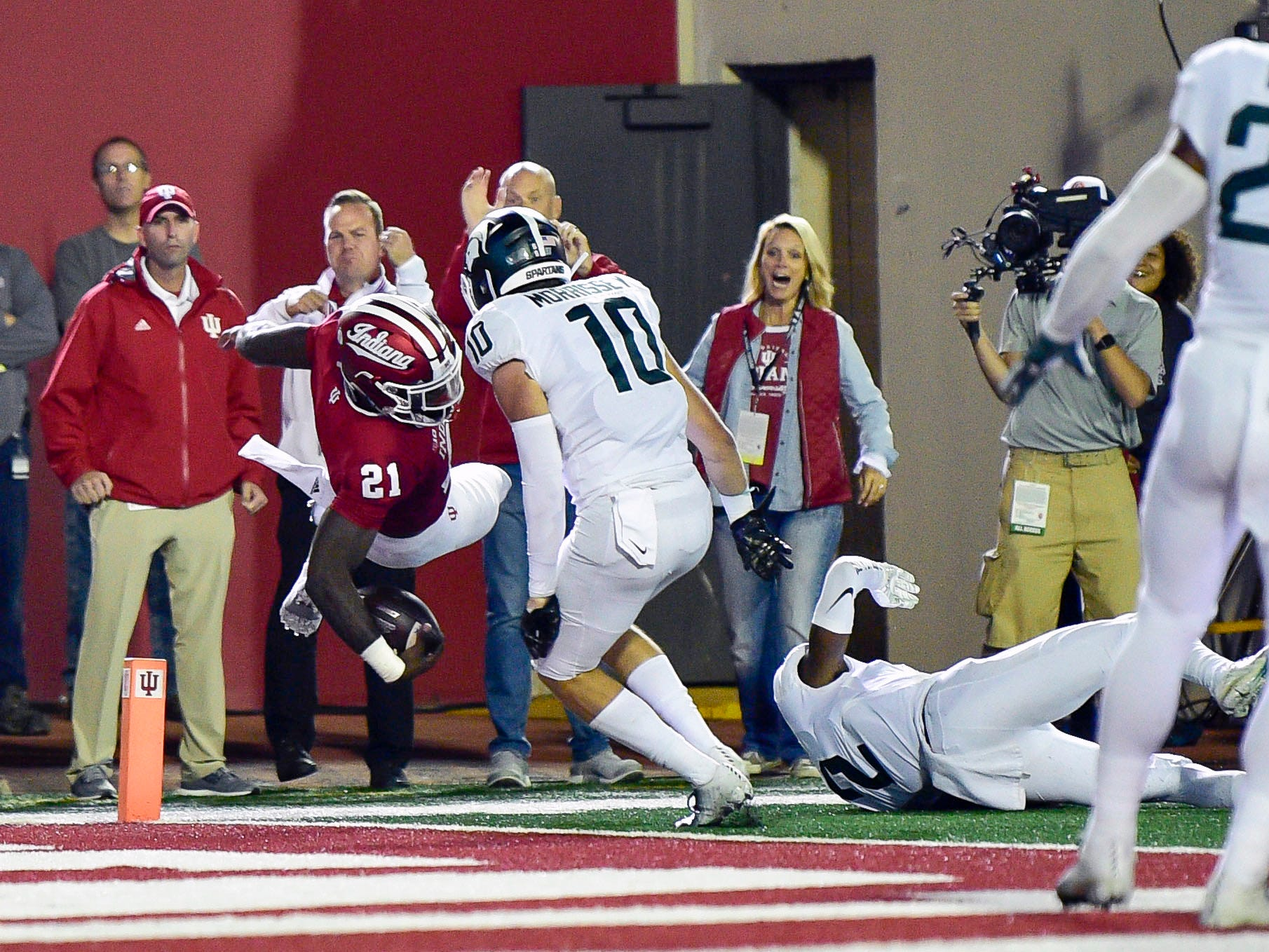 Indiana Hoosiers running back Stevie Scott (21) jumps to attempt to make a touchdown in front of Michigan State Spartans safety Matt Morrissey (10) during the first half of the game at Memorial Stadium.