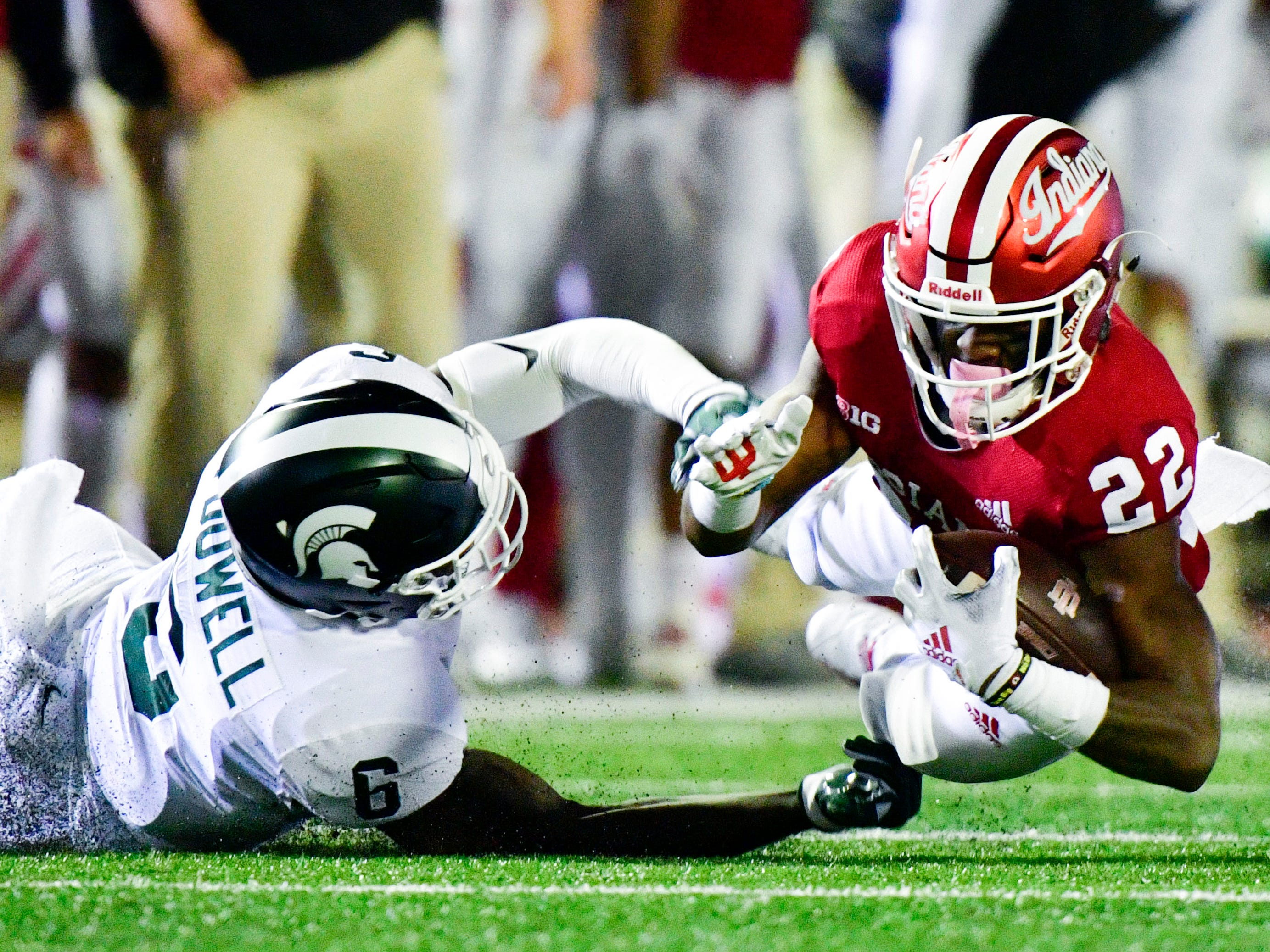 Indiana Hoosiers wide receiver Whop Philyor (22) dives to the ground while defended by Michigan State Spartans safety David Dowell (6) during the first half of the game at Memorial Stadium.