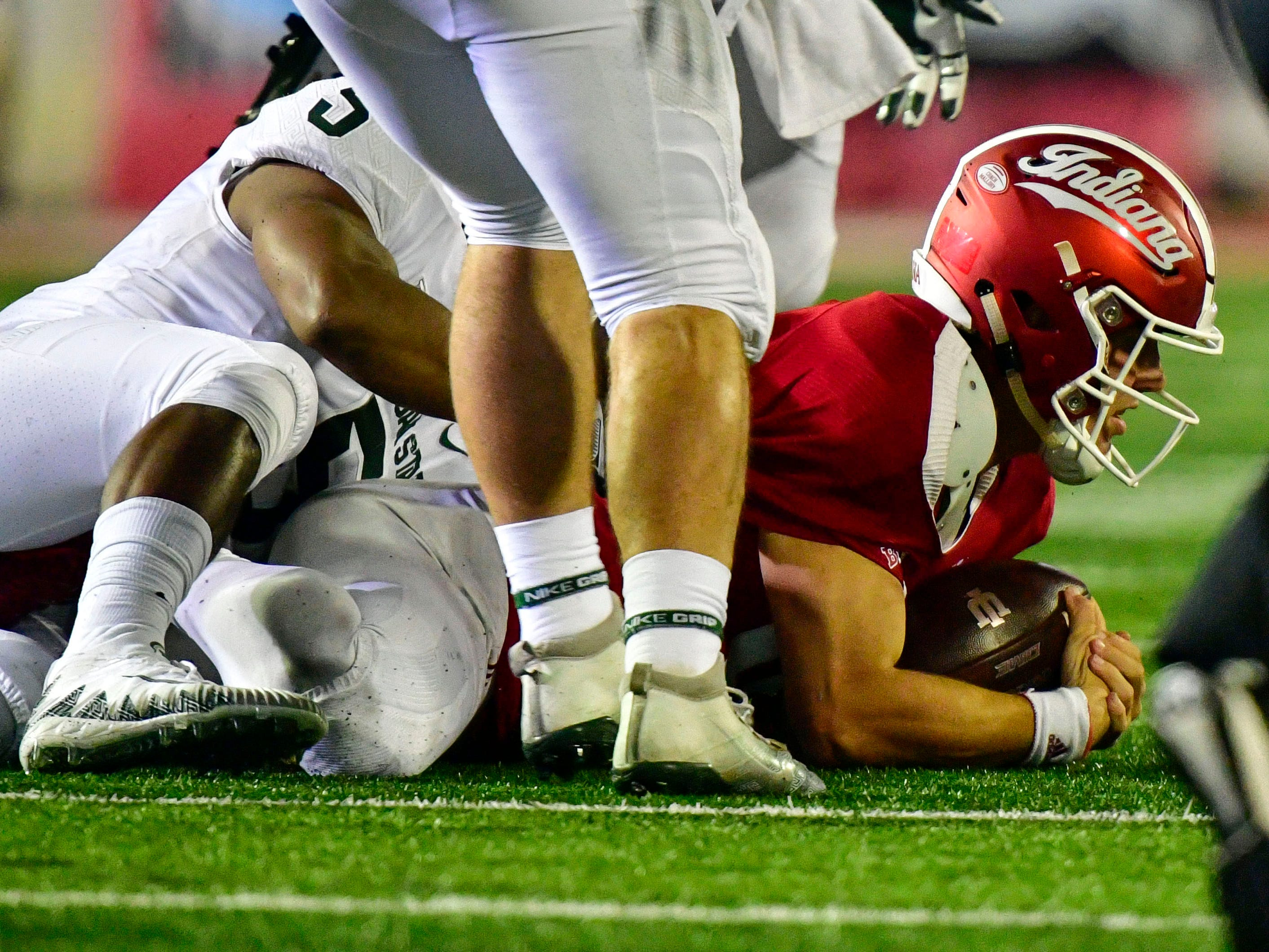 Indiana Hoosiers quarterback Peyton Ramsey (12) is sacked during the second half of the game by the Michigan State Spartans at Memorial Stadium. The Michigan State Spartans defeated the Indiana Hoosiers 35 to 21.