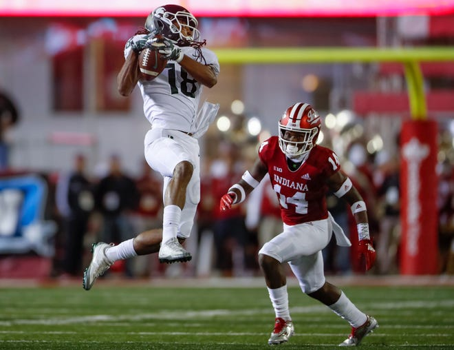 Felton Davis III #18 of the Michigan State Spartans catches the ball as Andre Brown Jr. #14 of the Indiana Hoosiers defends during the second at Memorial Stadium on September 22, 2018 in Bloomington, Indiana.