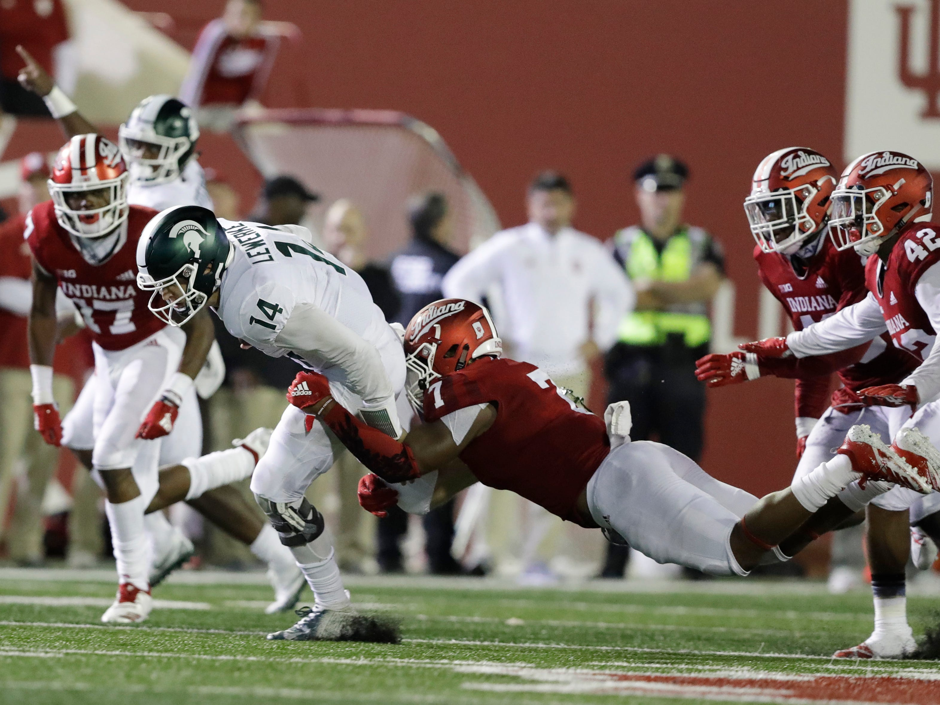 Michigan State quarterback Brian Lewerke (14) is tackled by Indiana's Reakwon Jones during the second half of an NCAA college football game, Saturday, Sept. 22, 2018, in Bloomington, Ind. Michigan State won 35-21.