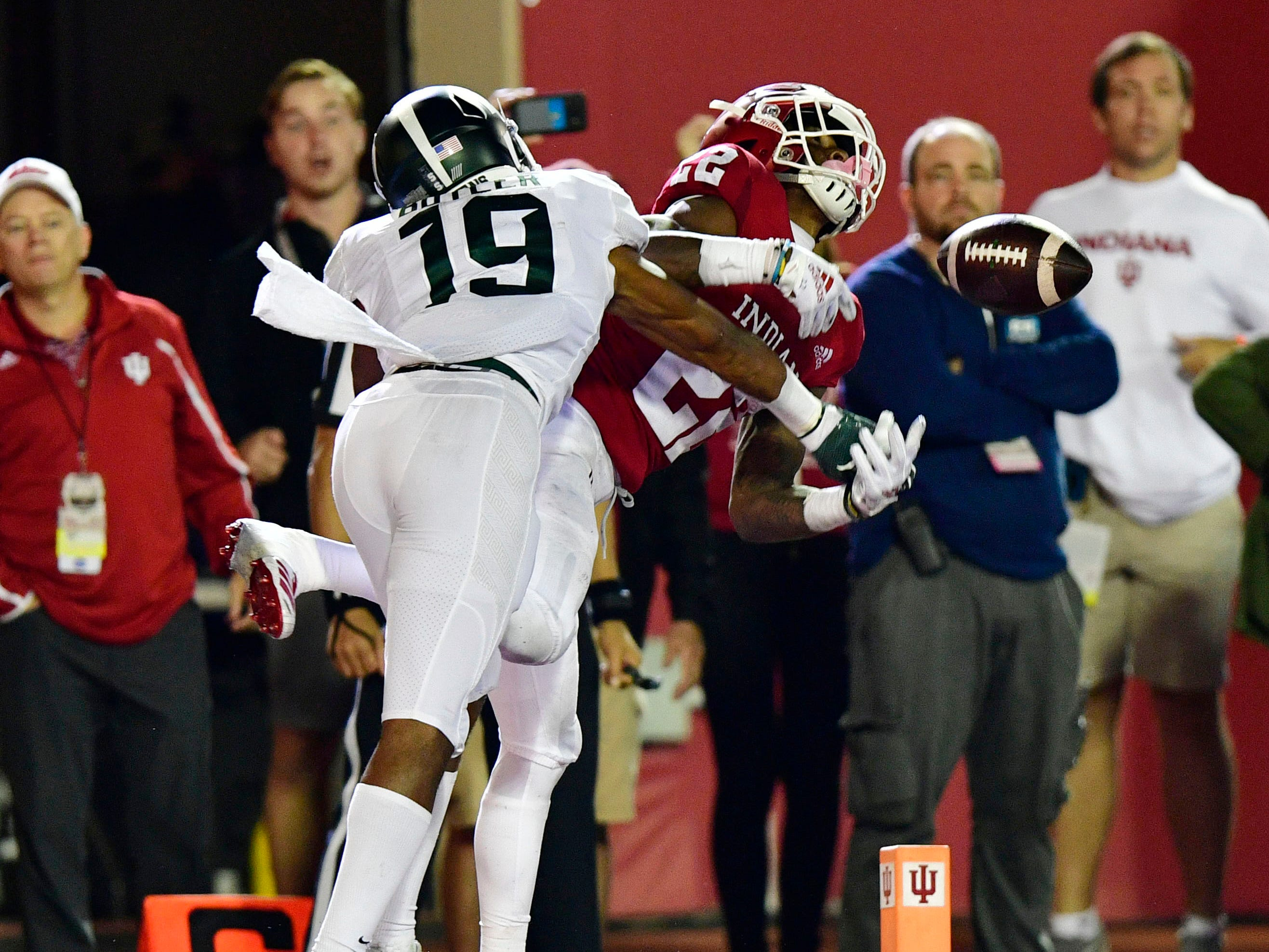 Indiana Hoosiers wide receiver Whop Philyor (22) misses a pass under coverage from Michigan State Spartans cornerback Josh Butler (19) during the second half of the game at Memorial Stadium. The Michigan State Spartans defeated the Indiana Hoosiers 35 to 21.