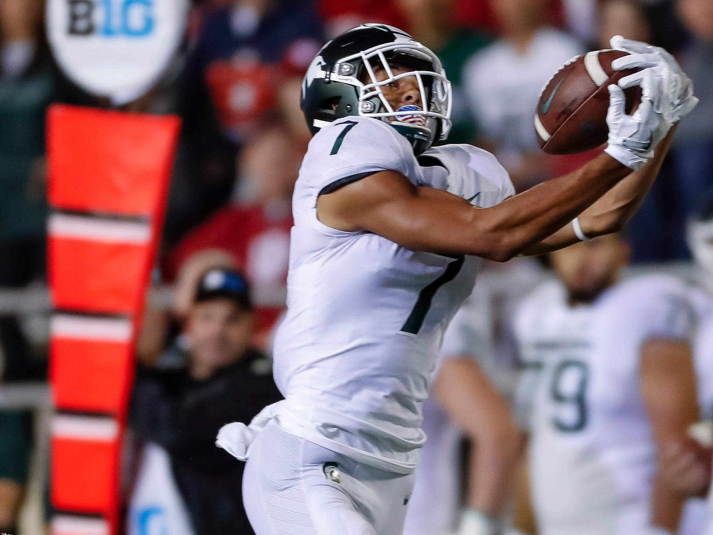 Cody White #7 of the Michigan State Spartans catches a pass during the first quarter of action against the Indiana Hoosiers at Memorial Stadium on September 22, 2018 in Bloomington, Indiana.