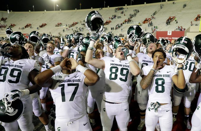 Michigan State celebrate after defeating Indiana, 35-21, in an NCAA college football game, Saturday, Sept. 22, 2018, in Bloomington, Ind.