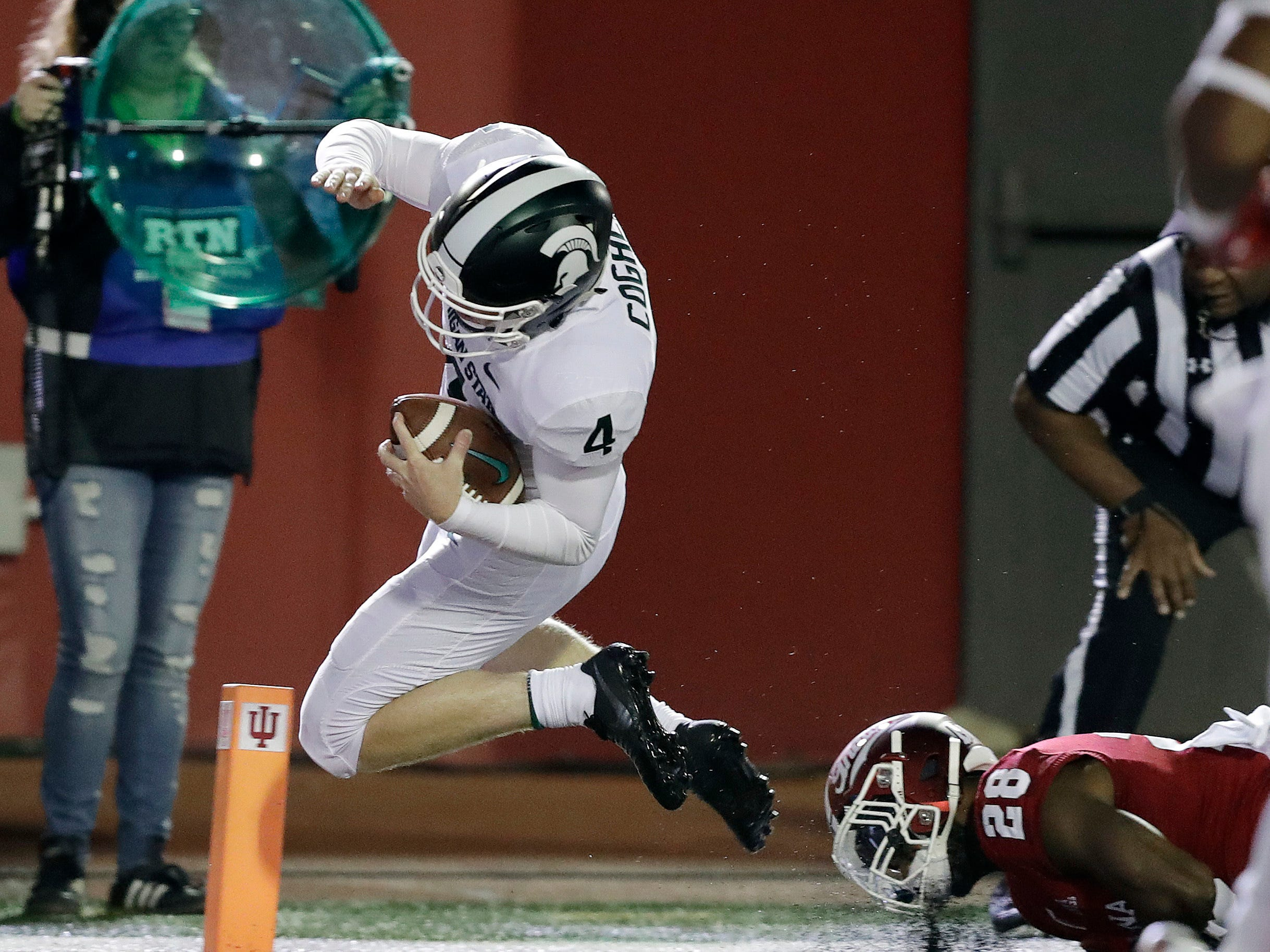 Michigan State's Matt Coghlin (4) dives for a touchdown against Indiana's A'Shon Riggins during the second half of an NCAA college football game, Saturday, Sept. 22, 2018, in Bloomington, Ind. Michigan State won 35-21.