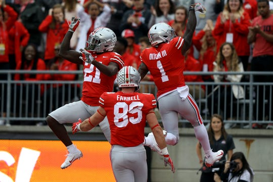 Ohio State H-back Parris Campbell celebrates one of his two TD catches with receiver Johnnie Dixon.