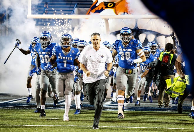 Memphis head coach Mike Norvell leads his team on to the field as they prepare to take on South Alabama in Memphis, Tenn., Saturday, September 22, 2018.