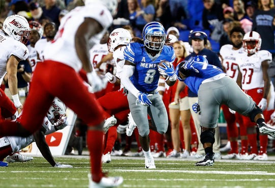 Memphis running back Darrell Henderson (middle) runs past the South Alabama defense during action in Memphis, Tenn., Saturday, September 22, 2018.