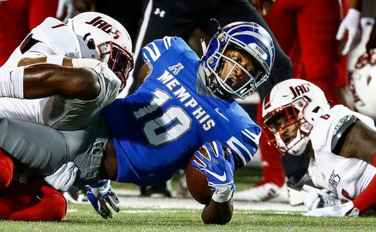 Memphis receiver Damonte Coxie (middle) dives for a first down against the South Alabama defense during action in Memphis, Tenn., Saturday, September 22, 2018.