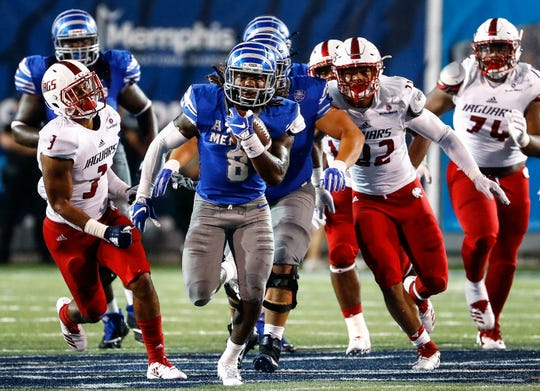Memphis running back Darrell Henderson (middle) scrambles past the South Alabama defense for a 54 yard touchdown during action in Memphis, Tenn., Saturday, September 22, 2018.