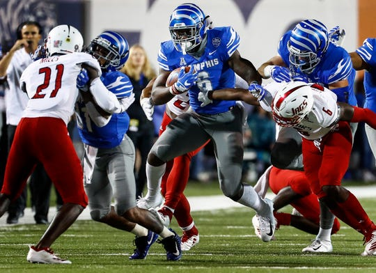Memphis running back Patrick Taylor Jr., (middle) scrambles past the South Alabama defense during action in Memphis, Tenn., Saturday, September 22, 2018.