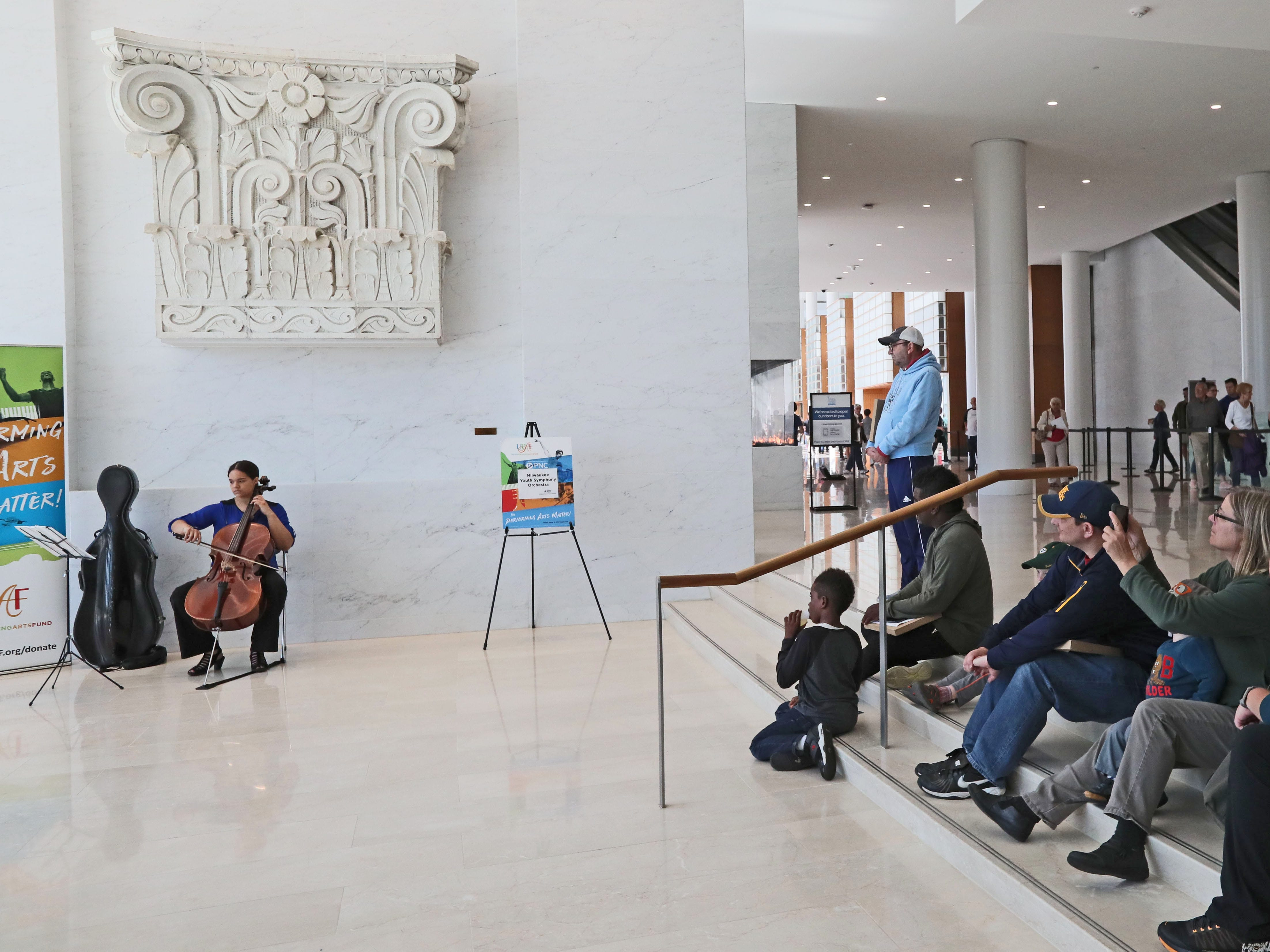 Mystique Evans of the Milwaukee Youth Symphony Orchestra plays the cello to raise money and awareness for the United Performing Arts Fund in the Giving Gallery at the Northwestern Mutual Tower and Commons. .  Artists from other UPAF member groups also performed.
