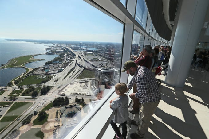 Visitors enjoy the view Sunday from the 32nd floor of the new Northwestern Mutual Tower and Commons during Doors Open Milwaukee 2018.