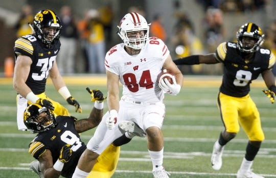 Tight end Jake Ferguson breaks a tackle in the first half against Iowa. He caught four passes for 58 yards in the game.