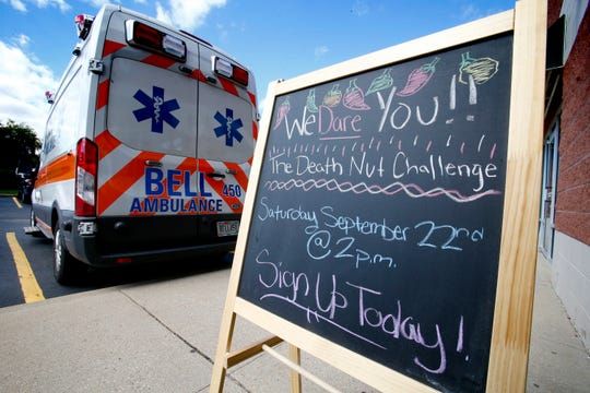 Just in case, Just Not Salt and Pepper of Greenfield had an ambulance crew stand by as eight people took the Death Nut Challenge of eating a progressive series of five insane hot spiced nuts on Sept. 22.