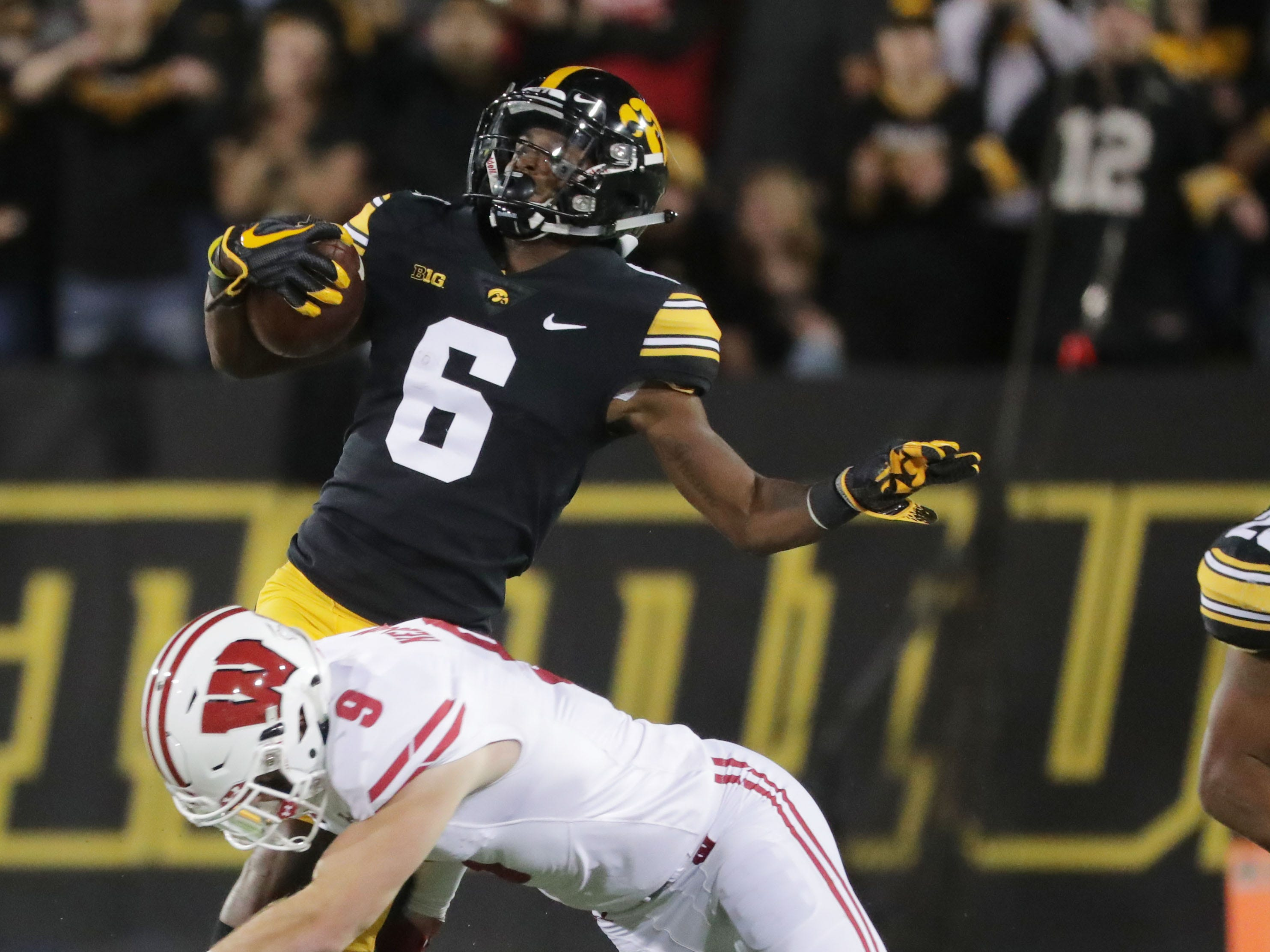 Wisconsin safety Scott Nelson misses a tackle on Iowa wide receiver Ihmir Smith-Marsette.