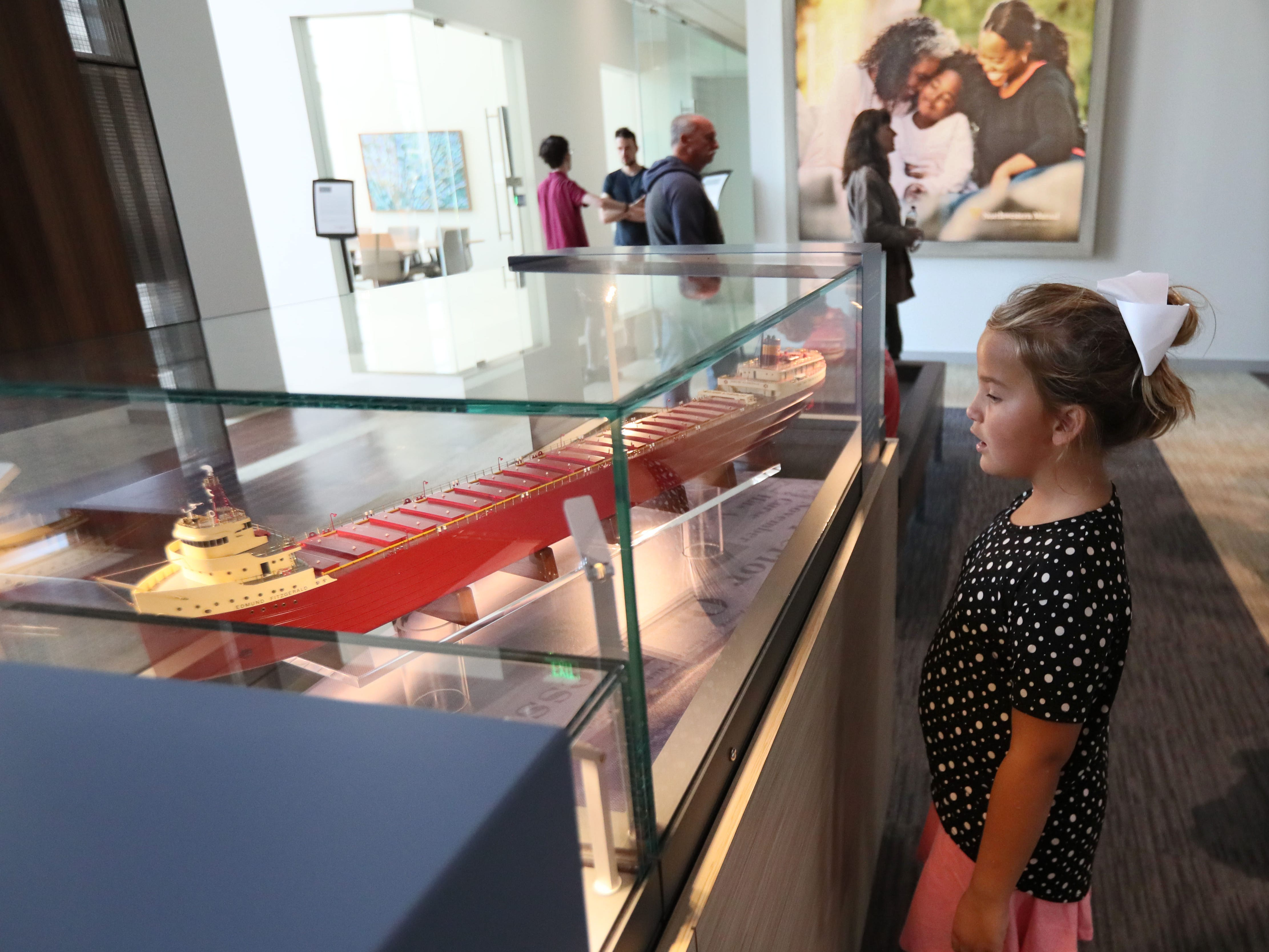 Lauren Pelz, 7, of Fond du Lac looks over a model of the Edmund Fitzgerald inside the Northwestern Mutual Tower and Commons. The ship was named for the chairman of Northwestern Mutual Life Insurance Co., which owned and insured the freighter.