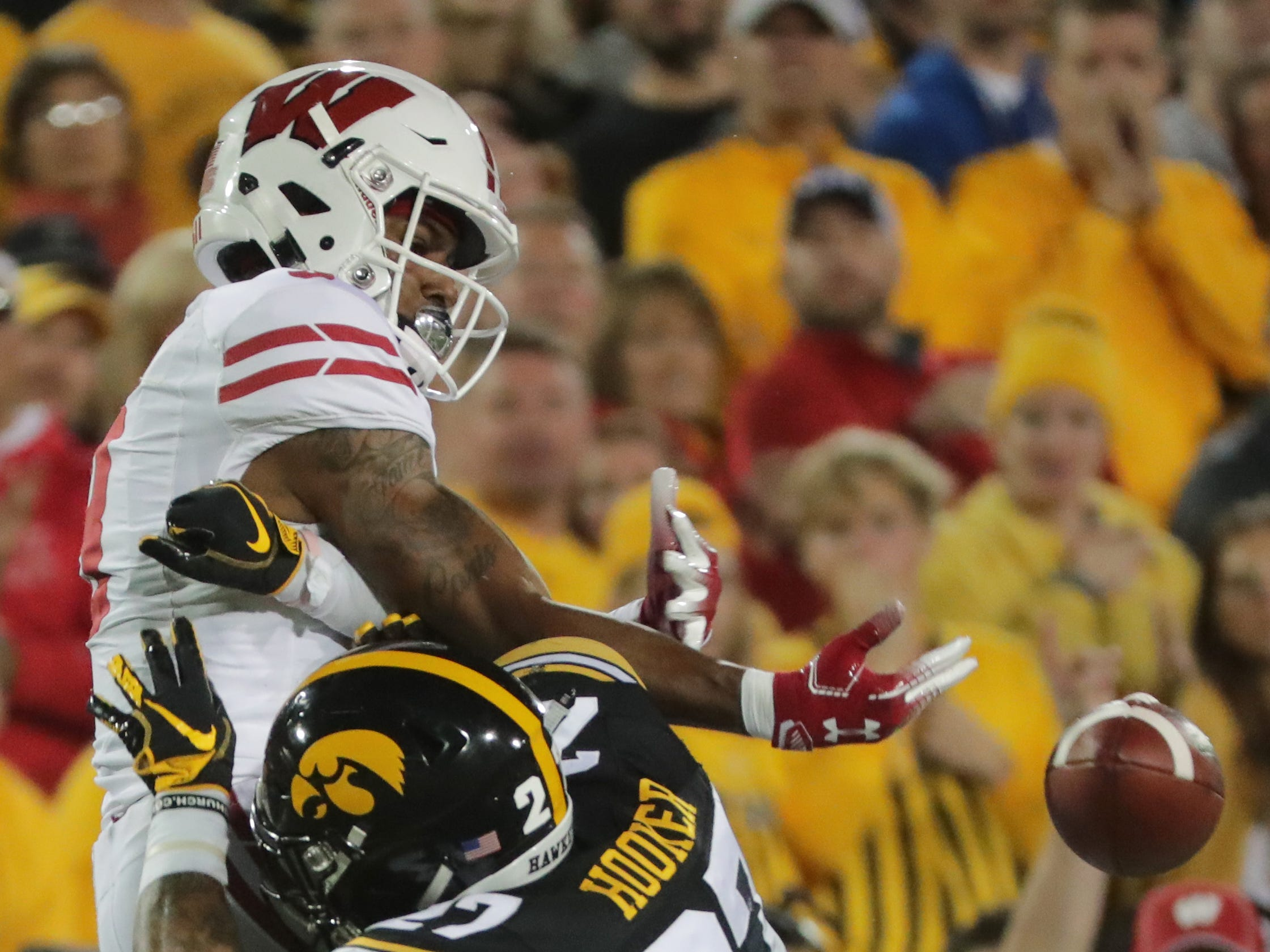 Iowa defensive back Amani Hooker breaks up a pass intended for Wisconsin wide receiver Kendric Pryor.
