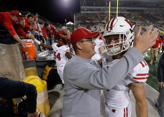 Wisconsin coach Paul Chryst hugs linebacker Andrew Van Ginkel after the Badgers' victory over Iowa.