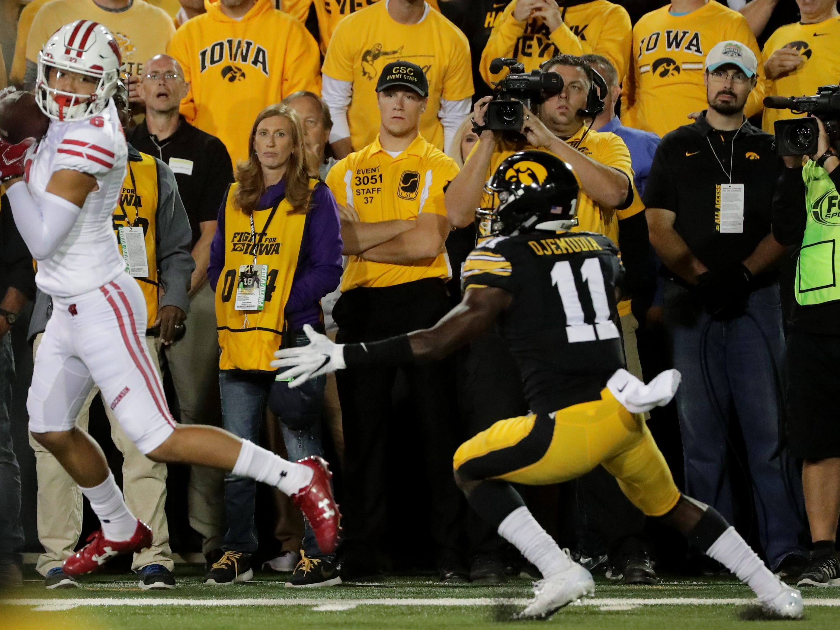 Wisconsin wide receiver Danny Davis III catches a go-ahead touchdown  while being covered by Iowa defensive back Michael Ojemudia.