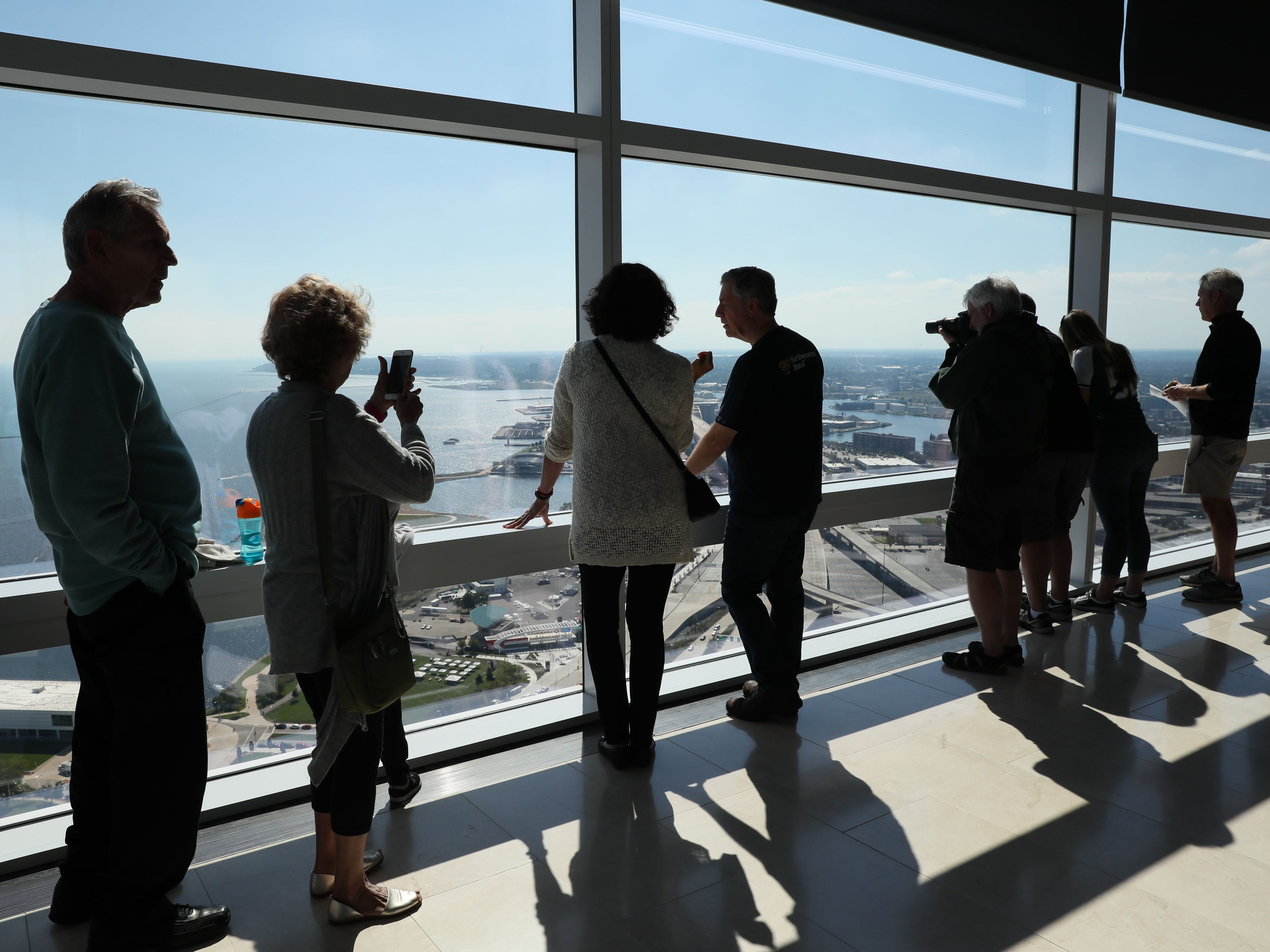 Visitors enjoy the view on the 32nd floor of the Northwestern Mutual Tower and Commons.