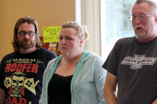 Kirk Anderson of New Holstein watches Cassandra Goeden and Just Not Salt and Pepper owner Tim Novak react to the heat from one of five rounds of progressively insane hot nuts in the Death Nut Challenge on Sept. 22.