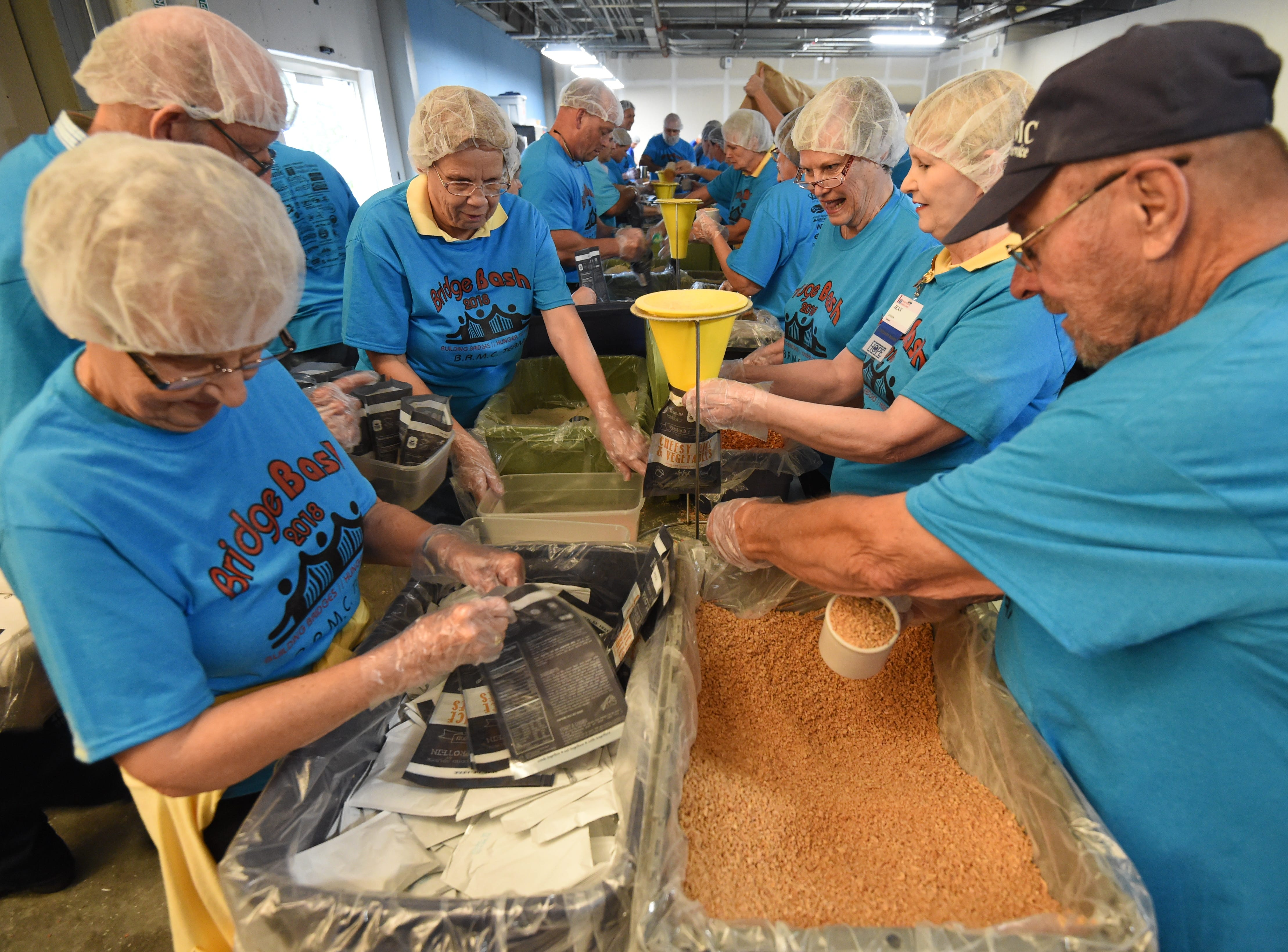 A scene from the 2018 Bridge Bash where several hundred thousand meals were gathered for those in need.