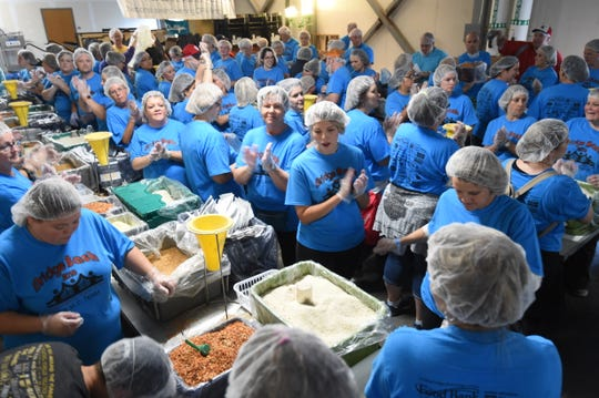 Almost 600 volunteers spent time preparing meals for the Food Bank of North Central Arkansas at last year's Bridge Bash. The event, and the assembly line-like preparation of meals, returns Saturday.