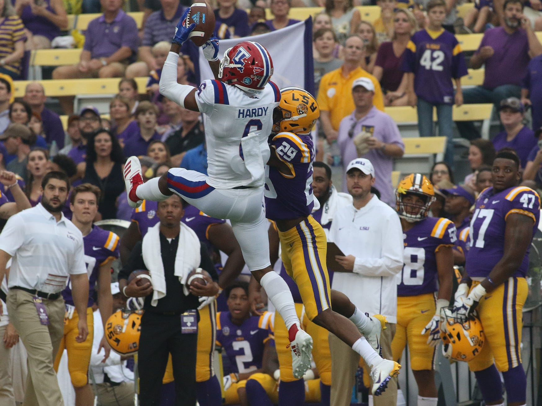 Louisiana Tech redshirt sophomore receiver Adrian Hardy (6) battles LSU cornerback Greedy Williams (29) for a pass during a game at Tiger Stadium Sept. 22, 2018.