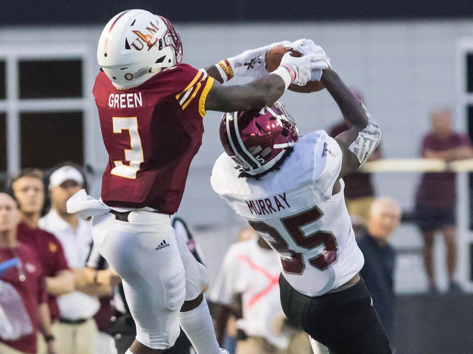 University of Louisiana at Monroe's Marcus Green (3) leaps to make a catch while Troy's Tyler Murray (35) attempts to intercept the ball during the game at Malone Stadium in Monroe, La. on Sept. 22.