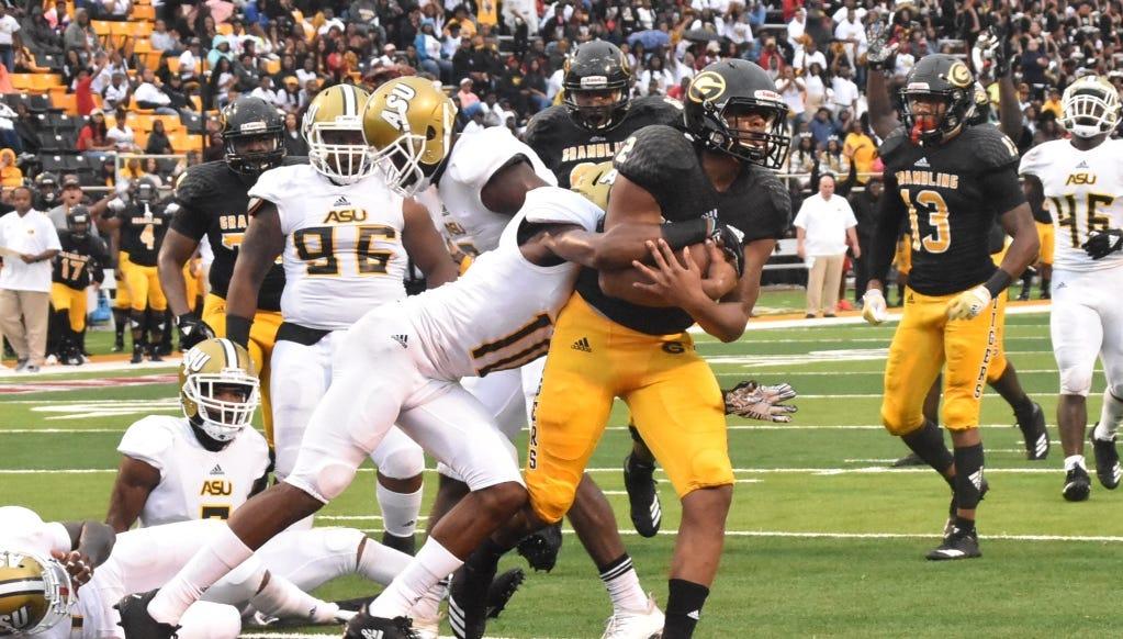 G-Men quarterback Aldon Clark skips into the end zone for a quarterback keeper
