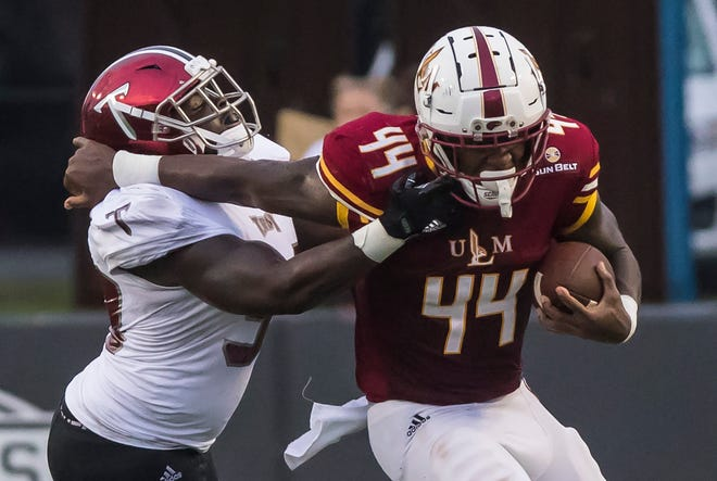 Derrick Gore (44) ran for a career-best 147 yards and two touchdowns on 16 carries in ULM's 45-20 win at Coastal Carolina. The Warhawks ran 242 yards and passed for 224 yards against the Chanticleers.