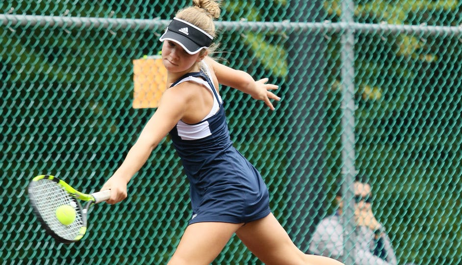 Chatham's Libby White hits a return shot in second singles during the finals of the Morris County girls tennis tournament at County College of Morris in Randolph on Sept. 23, 2018.