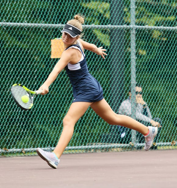 on sale e86c4 cf870 Chatham s Libby White hits a return shot in second singles during the  finals of the Morris