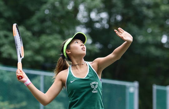 save off 2f224 e8de9 Kinnelon s Britany Lau hits a return shot during the Morris County  Tournament first singles final at