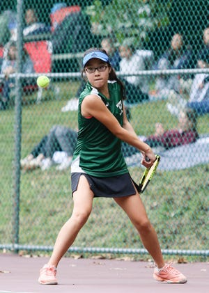 Kinnelon's Claire Zhang hits a return shot in second singles during the finals of the Morris County girls tennis tournament at County College of Morris in Randolph on Sept. 23, 2018.