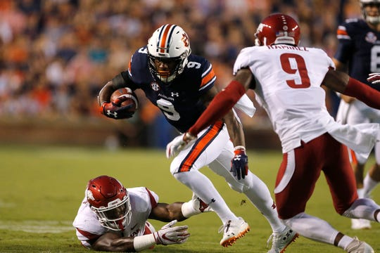 Auburn running back Kam Martin (9) carries the ball against Arkansas on Saturday, Sept. 22, 2018, in Auburn, Ala.