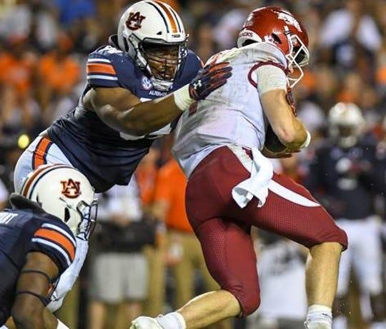 Auburn defensive lineman Tyrone Truesdell (94) hits Arkansas quarterback Ty Storey during the second half Saturday, Sept. 22, 2018, at Jordan-Hare Stadium in Auburn, Ala.
