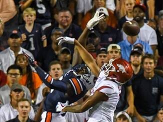 Auburn defensive back Jamel Dean (12) breaks up a pass in the end zone intended for Arkansas wide receiver Jonathan Nance (7) during the first quarter Saturday, Sept. 22, 2018, at Jordan-Hare Stadium in Auburn, Ala.