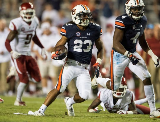 Auburn's Ryan Davis (23) returns a punt against Arkansas  at Jordan-Hare Stadium in Auburn, Ala., on Saturday, Sept. 21, 2018. Auburn defeated Arkansas 34-3.