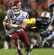 Auburn defensive back Daniel Thomas (24) gets a hand on Arkansas quarterback Ty Storey during the second quarter Saturday, Sept. 22, 2018, at Jordan-Hare Stadium in Auburn, Ala.
