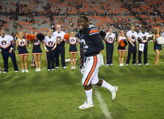 Auburn's K.J. Britt (33) smiles as he runs off the the field at the end of the game at Jordan-Hare Stadium in Auburn, Ala., on Saturday, Sept. 21, 2018. Auburn defeated Arkansas 34-3.