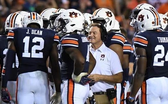 Auburn secondary coach Greg Brown talks to players during the second quarter Saturday, Sept. 22, 2018, at Jordan-Hare Stadium in Auburn, Ala.