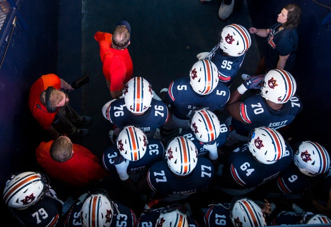 Auburn players and coaches wait to introduced before taking on Arkansas at Jordan-Hare Stadium in Auburn, Ala., on Saturday, Sept. 21, 2018. Auburn defeated Arkansas 34-3.