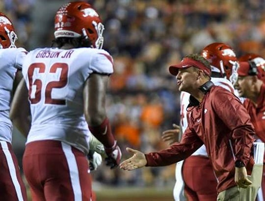 Arkansas head coach Chad Morris talks to players on the sidelines during a game against Auburn on Sept. 22.