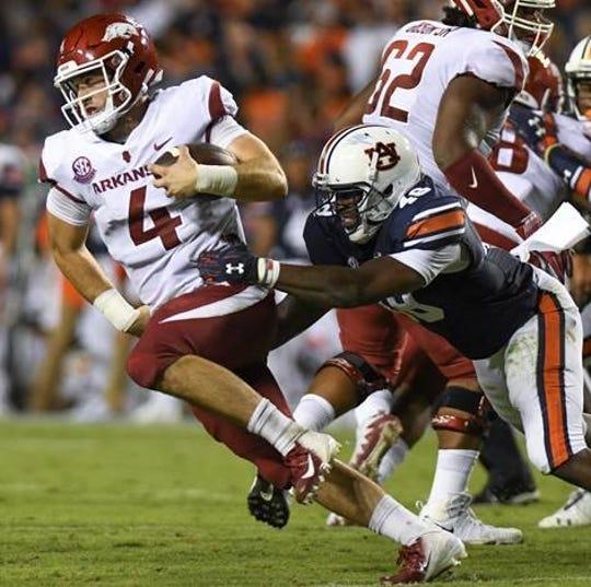 Auburn linebacker Montavious Atkinson (48) tackles Arkansas quarterback Ty Storey during the second quarter Saturday, Sept. 22, 2018, at Jordan-Hare Stadium in Auburn, Ala.