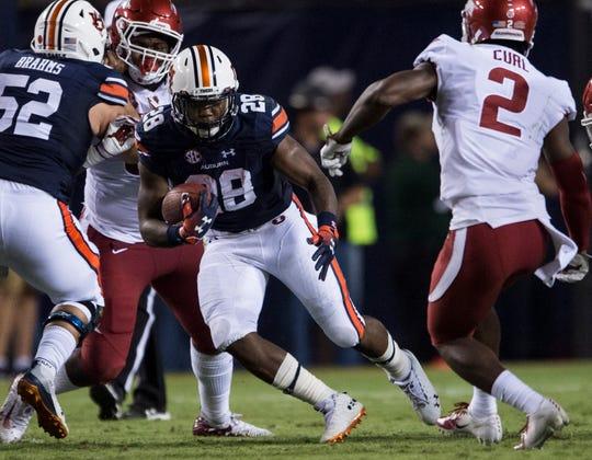 Auburn's JaTarvious Whitlow (28) runs the ball against Arkansas at Jordan-Hare Stadium in Auburn, Ala., on Saturday, Sept. 21, 2018. Auburn leads Arkansas 17-0 at halftime.