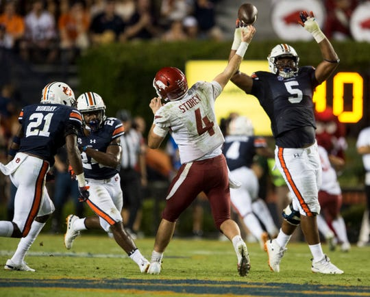 Auburn's Derrick Brown (5) tips a Arkansas' Ty Storey (4) pass at Jordan-Hare Stadium in Auburn, Ala., on Saturday, Sept. 21, 2018. Auburn defeated Arkansas 34-3.